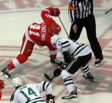 Luke Glendening takes a faceoff against Jason Spezza of the Dallas Stars.