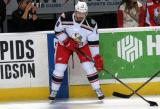 Brian Lashoff holds onto the puck at the blue line during pre-game warmups before a Grand Rapids Griffins game.