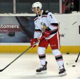 Ryan Sproul skates with the puck during pre-game warmups before a Grand Rapids Griffins game.