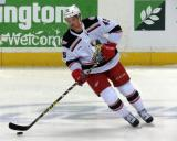 Colin Campbell skates with the puck during pre-game warmups before a Grand Rapids Griffins game.