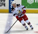 Nick Jensen skates across the blue line during pre-game warmups before a Grand Rapids Griffins game.