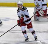 Mark Zengerle skates in the neutral zone during pre-game warmups before a Grand Rapids Griffins game.