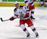 Joel Rechlicz skates in the neutral zone during pre-game warmups before a Grand Rapids Griffins game.