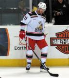 Daniel Cleary stands at the boards during pre-game warmups before a Grand Rapids Griffins game.