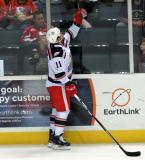 Daniel Cleary tosses a puck over the glass to a young fan during pre-game warmups before a Grand Rapids Griffins game.