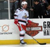 Daniel Cleary stands at the bench during pre-game warmups before a Grand Rapids Griffins game.