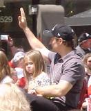 Steve Yzerman holds his daughter and waves to the fans during the parade honoring the Red Wings' 2002 Stanley Cup Championship.