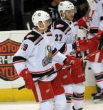 Tomas Nosek and Martin Frk skate near the bench during pre-game warmups before a Grand Rapids Griffins game.
