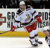 Ryan Sproul skates near the bench during pre-game warmups before a Grand Rapids Griffins game.