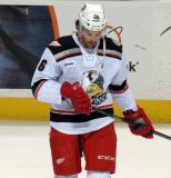 Eric Tangradi skates near the boards during pre-game warmups before a Grand Rapids Griffins game.