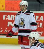 Robbie Russo stands near the boards during pre-game warmups before a Grand Rapids Griffins game.