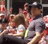 Steve Yzerman leans back and relaxes during the parade honoring the Red Wings' 2002 Stanley Cup Championship.