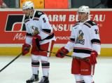 Robbie Russo and Zach Nastasiuk stand during pre-game warmups before a Grand Rapids Griffins game.