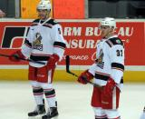 Robbie Russo and Zach Nastasiuk react to something that happened during pre-game warmups before a Grand Rapids Griffins game.