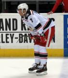 Ryan Sproul crouches near the bench during pre-game warmups before a Grand Rapids Griffins game.