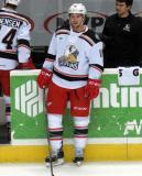 Xavier Ouellet stands at the bench during pre-game warmups before a Grand Rapids Griffins game.
