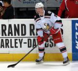 Mark Zengerle looks to make a pass during pre-game warmups before a Grand Rapids Griffins game.