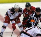 Mitch Callahan lines up next to Christoph Bertschy of the Iowa Wild for the opening faceoff of a Grand Rapids Griffins game.