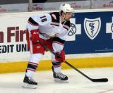 Xavier Ouellet gets set for a faceoff during a Grand Rapids Griffins game.