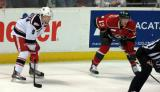 Mark Zengerle lines up opposite Gustav Olofsson of the Iowa Wild for a faceoff in a Grand Rapids Griffins game.
