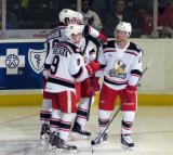 Mark Zengerle, Eric Tangradi, Nathan Paetsch, and Nick Jensen celebrate a goal by Tangradi during a Grand Rapids Griffins game.