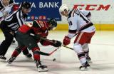 Tomas Nosek takes a faceoff against Grayson Downing of the Iowa Wild during a Grand Rapids Griffins game.