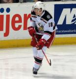 Tomas Nosek skates up ice during a Grand Rapids Griffins game.