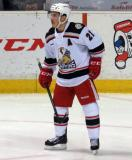 Andy Miele looks back to the bench during a stop in play in a Grand Rapids Griffins game.