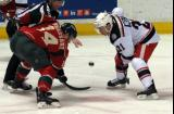 Andy Miele takes a faceoff against Brady Brassart of the Iowa Wild during a Grand Rapids Griffins game.