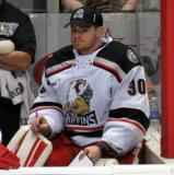 Tom McCollum sits on the bench during a stop in play in a Grand Rapids Griffins game.