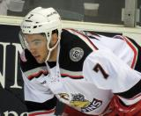 Ryan Sproul crouches near the boards during a stop in play in a Grand Rapids Griffins game.