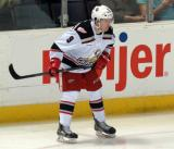 Mark Zengerle crouches near the boards during a stop in play in a Grand Rapids Griffins game.