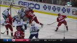 Henrik Zetterberg snaps a low-angle shot over the shoulder of Vancouver goalie Ryan Miller to tie the game late in regulation.