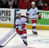 Colin Campbell and Mark Zengerle skate near the blue line during pre-game warmups before the Grand Rapids Griffins' Purple Game.