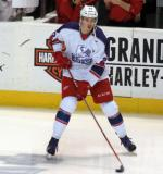 Louis-Marc Aubry carries the puck during pre-game warmups before the Grand Rapids Griffins' Purple Game.