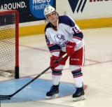 Mitch Callahan scoops pucks out of the net during pre-game warmups before the Grand Rapids Griffins' Purple Game.