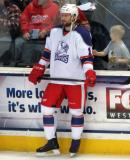 Brian Lashoff stands at the boards during pre-game warmups before the Grand Rapids Griffins' Purple Game.