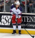 Tyler Bertuzzi plays with a puck at the boards during pre-game warmups before the Grand Rapids Griffins' Purple Game.