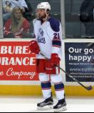 Eric Tangradi stands at the boards during pre-game warmups before the Grand Rapids Griffins' Purple Game.