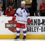 Daniel Cleary stands at the bench during pre-game warmups before the Grand Rapids Griffins' Purple Game.