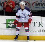Ryan Sproul stands at the bench during pre-game warmups before the Grand Rapids Griffins' Purple Game.