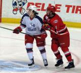 Mitch Callahan of the Griffins and Trevor Carrick of the Charlotte Checkers battle for position during the Grand Rapids Griffins' Purple Game.