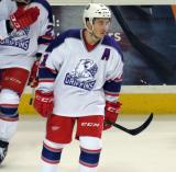Andy Miele skates back to center ice after celebrating a goal during the Grand Rapids Griffins' Purple Game.