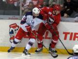 Joel Chouinard of the Griffins and Brendan Woods of the Charlotte Checkers fight for the puck along the boards during the Grand Rapids Griffins' Purple Game.