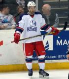 Joel Chouinard stands near the boards during a stop in play in the Grand Rapids Griffins' Purple Game.