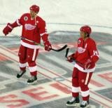 Nicklas Lidstrom and Brendan Shanahan stand at center ice during pre-game warmups before the 2016 Stadium Series Alumni Game at Coors Field.