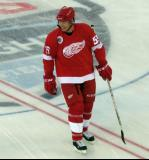 Larry Murphy skates at center ice during pre-game warmups before the 2016 Stadium Series Alumni Game at Coors Field.