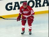 Darren McCarty crouches near the boards during pre-game warmups before the 2016 Stadium Series Alumni Game at Coors Field.