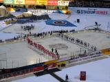 The teams line up at their respective blue lines for player introductions before the 2016 Stadium Series Alumni Game at Coors Field.
