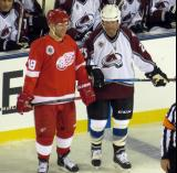 Kirk Maltby and Shjon Podein line up next to each other for a faceoff during the 2016 Stadium Series Alumni Game at Coors Field.
